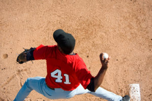 young athlete throwing baseball